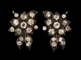 A PAIR OF 18K GOLD AND SILVER CLIP-ON EARRINGS