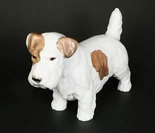 A ROSENTHAL PORCELAIN FIGURE OF A DOG
