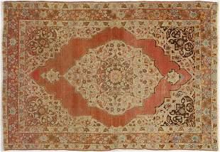AN OLD RUG, PROBABLY TURKISH, MID 20TH CE0NTURY