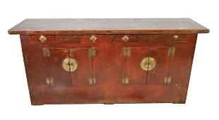 A LARGE WOOD SIDEBOARD