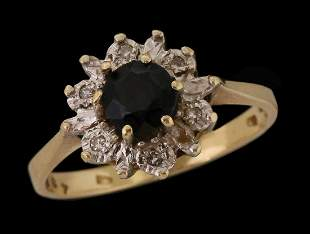 A 14K GOLD RING