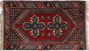 AN AFGHAN RUG, SECOND HALF OF 20th CENTURY