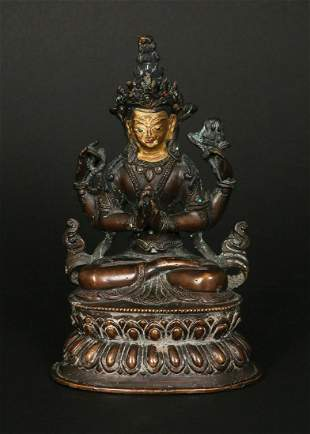 A TIBETAN BRONZE SCULPTURE WITH INSET CORAL AND