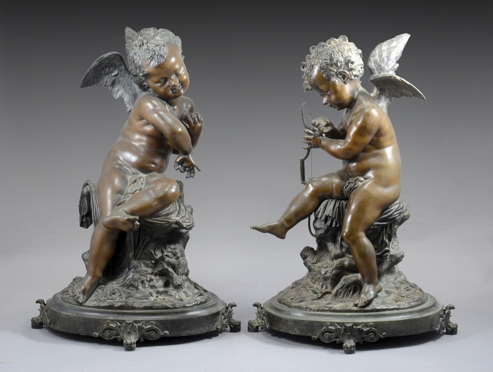 A PAIR OF BRONZE SCULPTURES IN THE FORM OF CUPID
