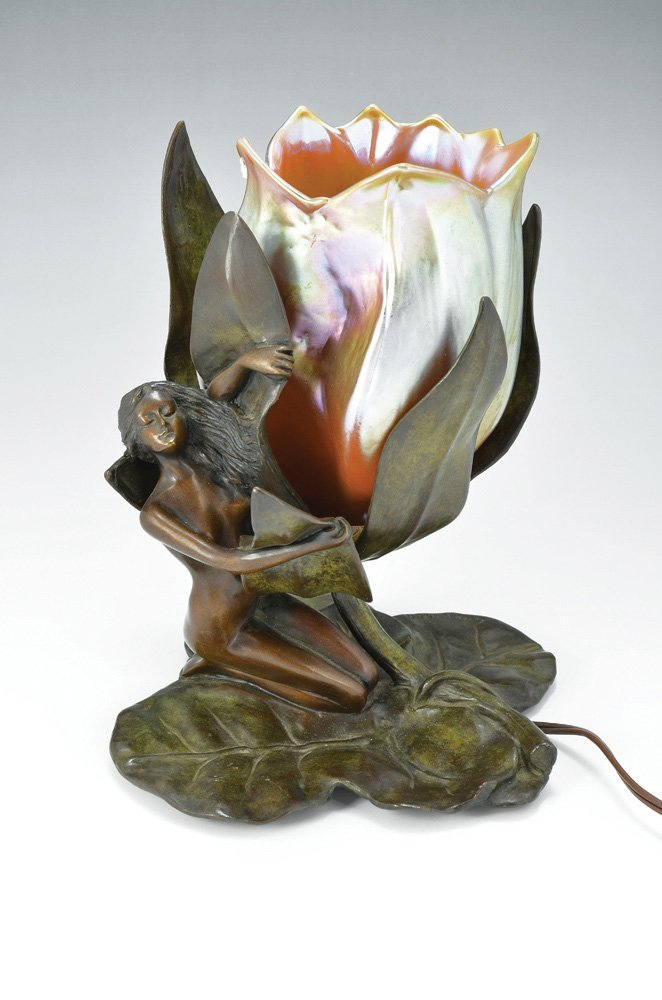 AN ART NOUVEAU STYLE BRONZE LAMP IN THE FORM OF A