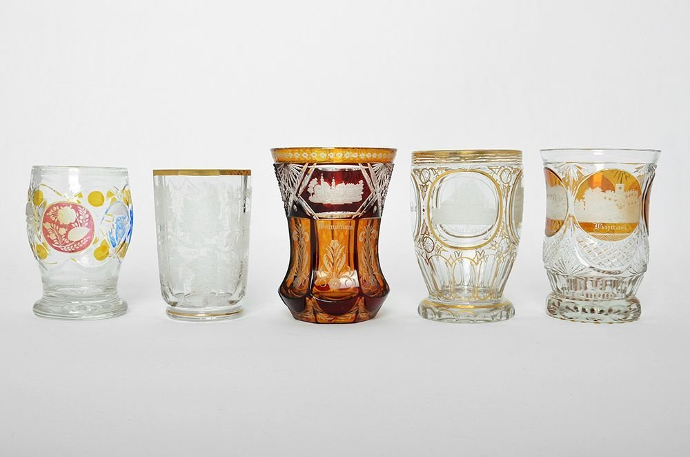 AN ASSORTED GROUP OF BOHEMIAN CRYSTAL GLASS CUPS