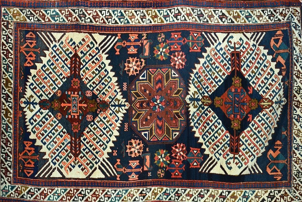 AN OLD CAUCASIAN RUG