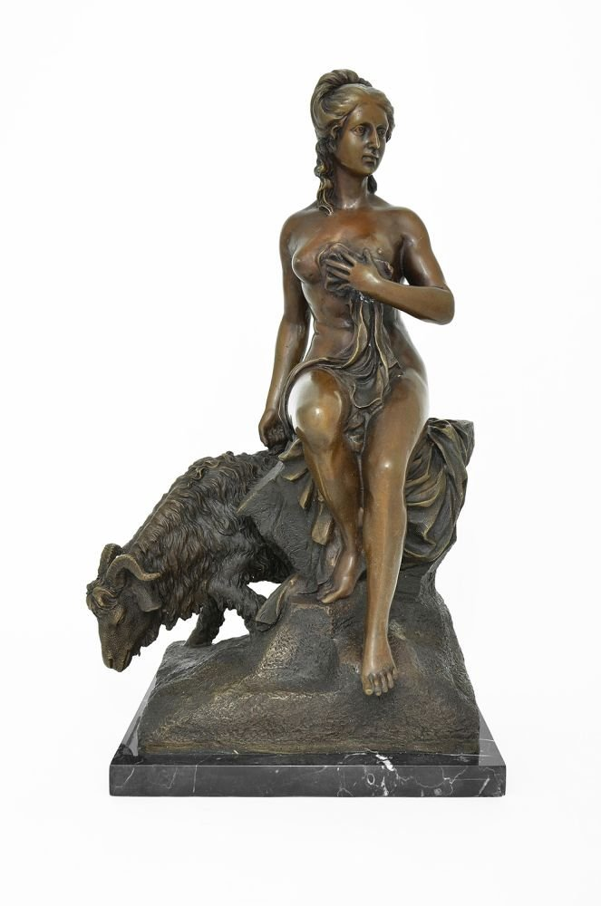 A BRONZE FIGURE OF A NUDE GIRL AND A GOAT