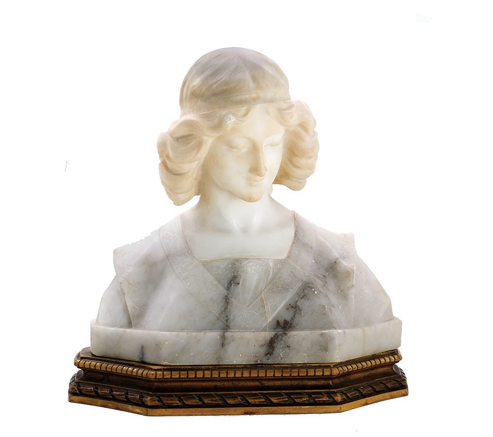 A CARVED MARBLE BUST OF JEANNE D'ARC