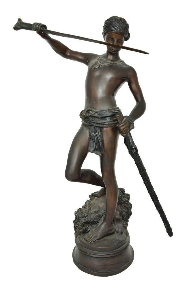 A BRONZE FIGURE OF DAVID WITH THE SEVERED HEAD OF