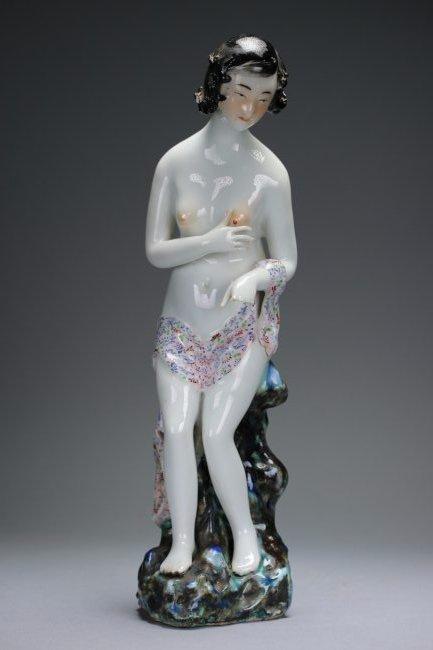 A polychrome enameled figure of a lady