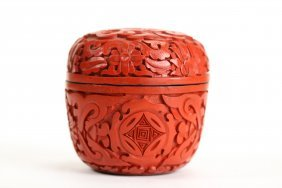 A Carved Cinnabar Circular Lacquer Box and Cover