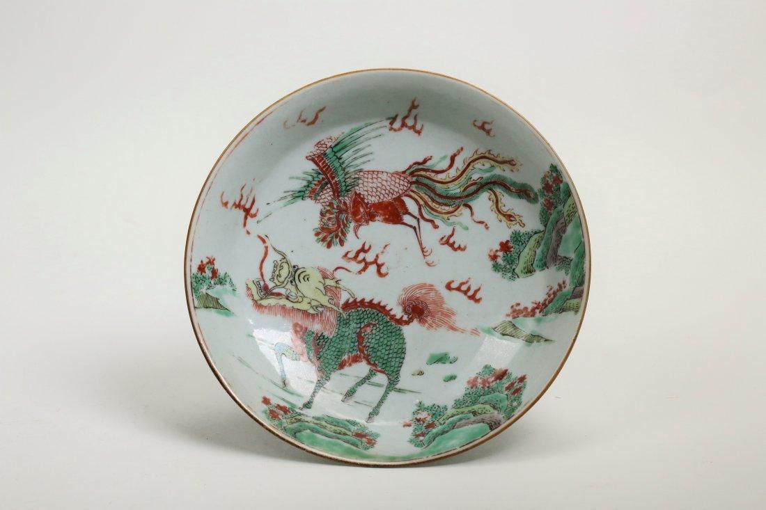 A wucai phoenix and qilin dish ,Mid 17th century