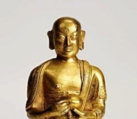 A gilt bronze figure of Ksitigarbha, Qing dynasty
