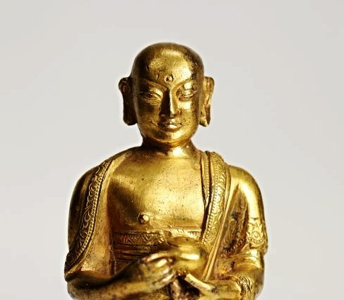 A gilt bronze figure of Ksitigarbha, Qing dynasty