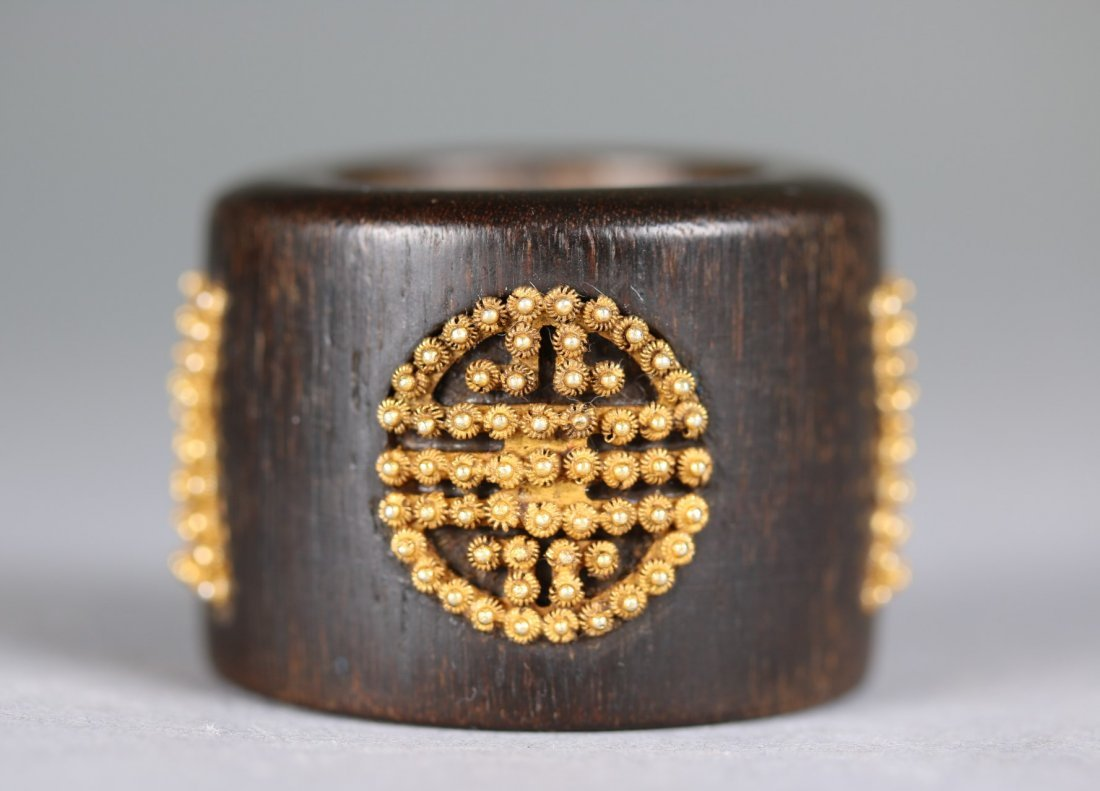 An Imperial Agarwood Archers Ring with Gold inlays