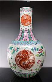 """A Chinese wucai """"Dragon and phoenix"""" vase, Qing dynasty"""