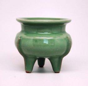 A Chinese Celadon Glazed Tri-pod Censer, Qing Dynasty