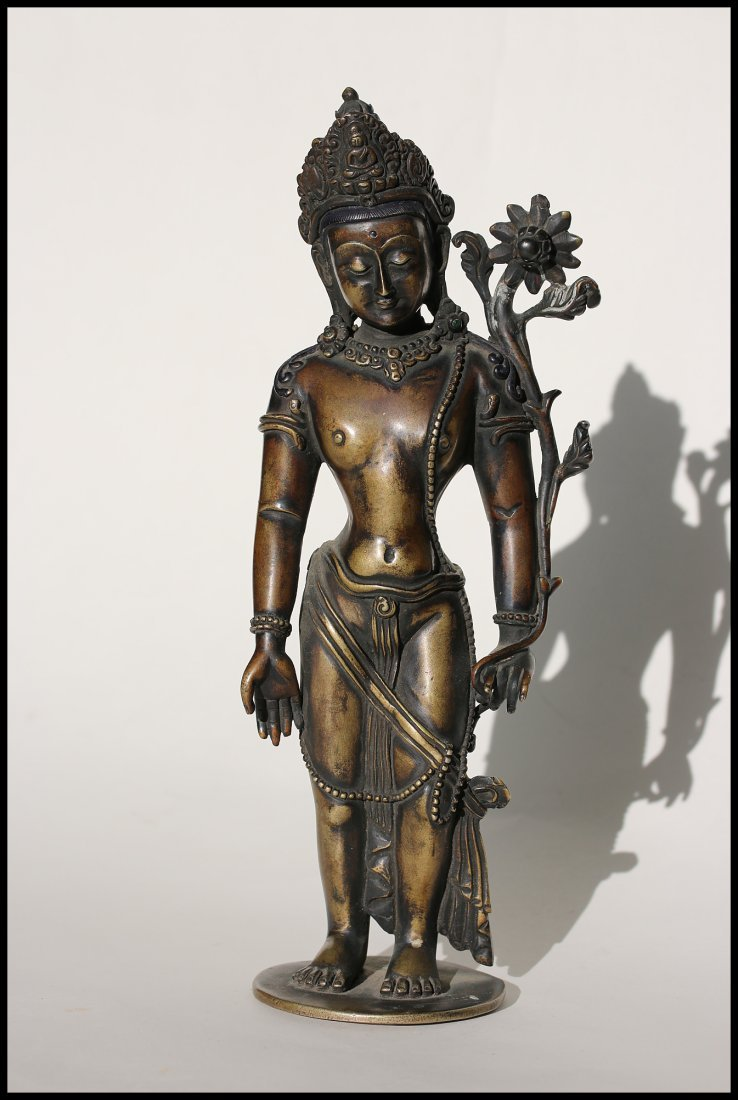A Tibetan  cast bronze figure of Padmapani,19th century