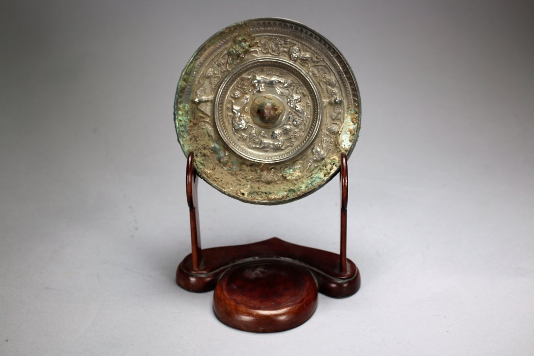 A Chinese circular bronze mirror,Tang dynasty