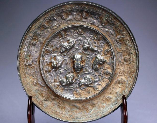 A Chinese circular bronze millor,Tang dynasty