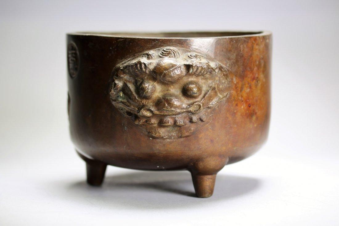 Bronze censor with lion motif handle