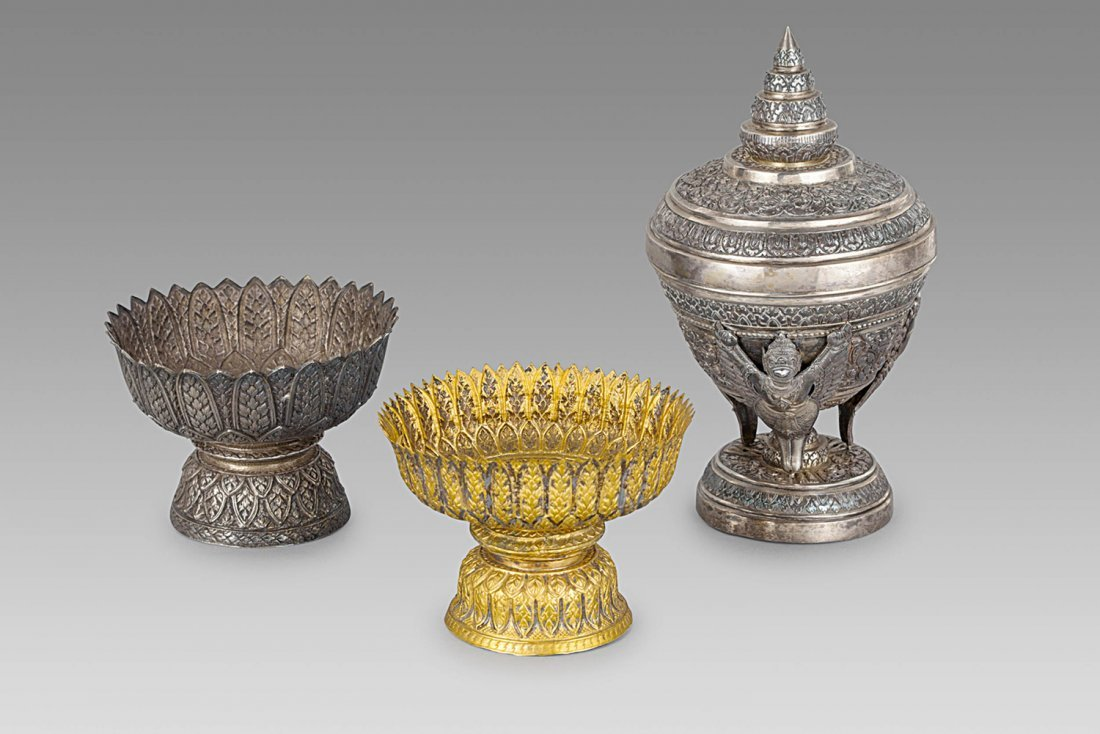 TWO SILVER AND GILT-METAL RITUAL STANDING BOWLS,