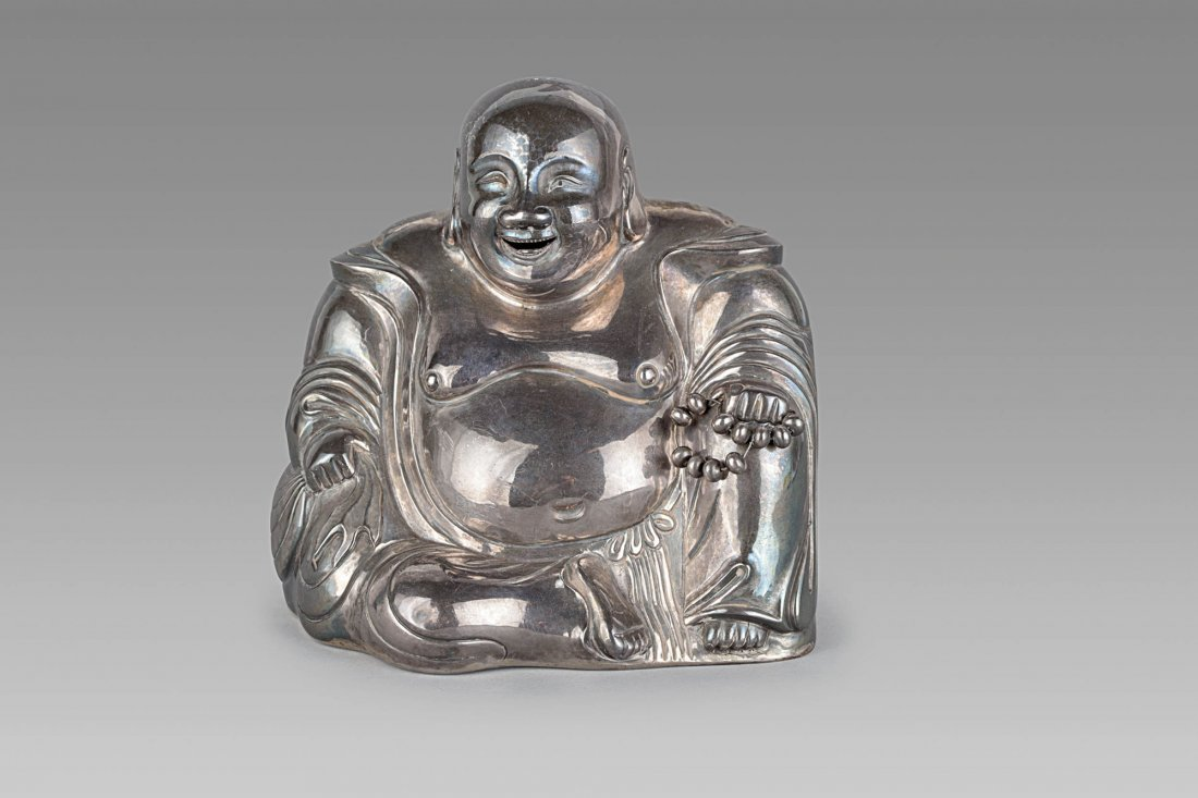 A SILVER FIGURE OF A SEATED BUDDHA, CHINA, LATE QING