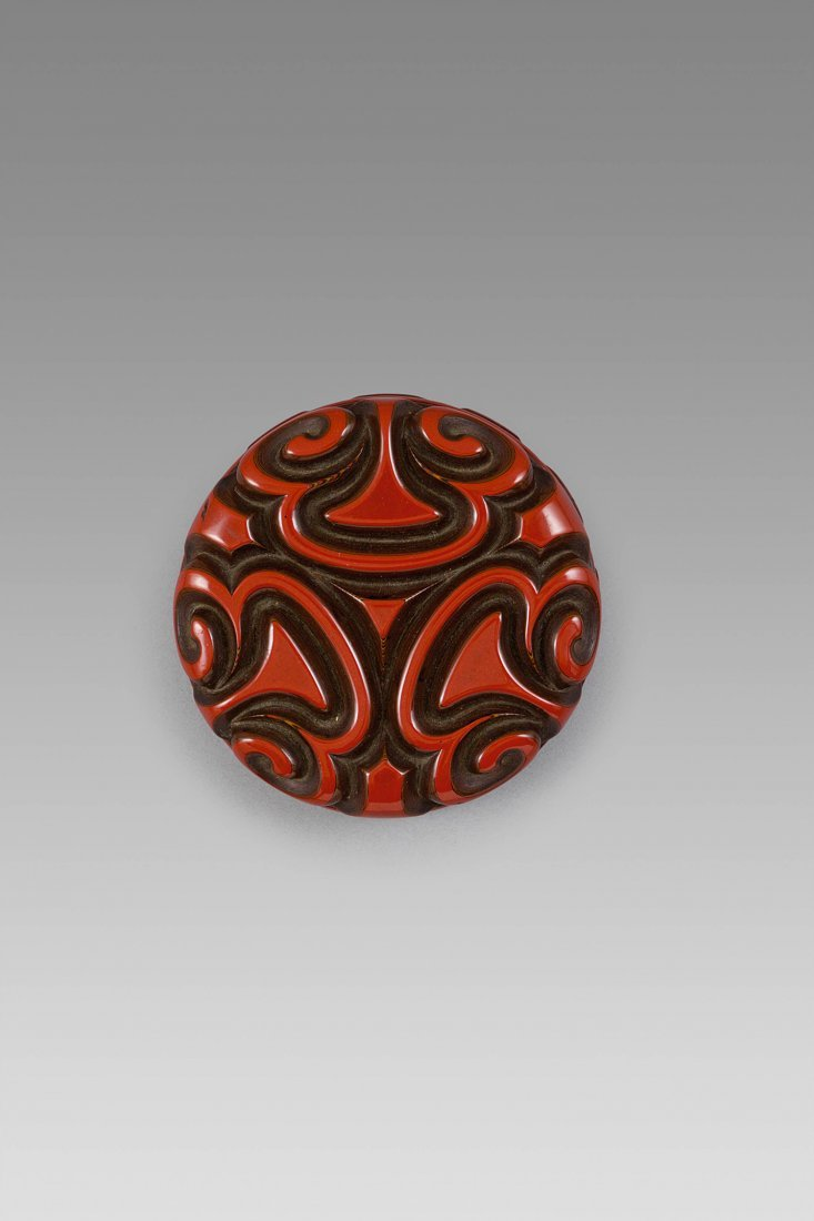 AN EXTREYMELY RARE AND FINELY CARVED PURPLE–RED-BROWN