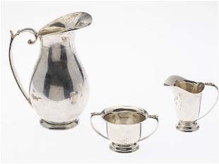 Sanburn Mexican Silver Pitcher and a Cream and Sugar