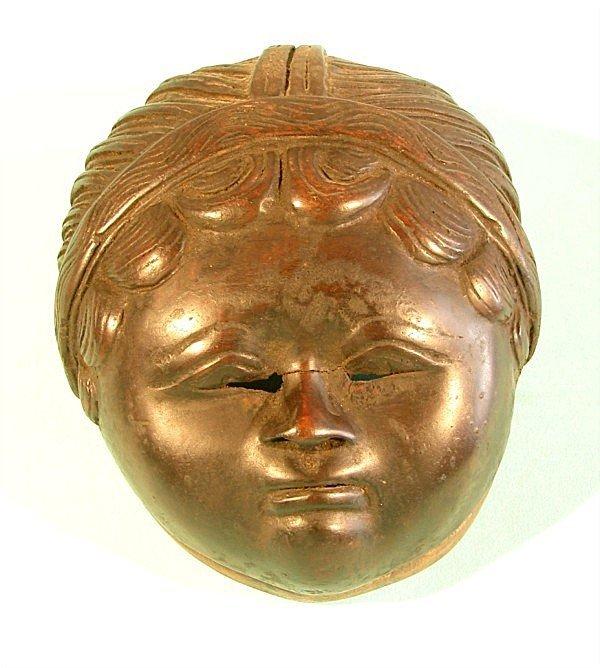 452: Hand carved wood mask, dark finish, holes for stri