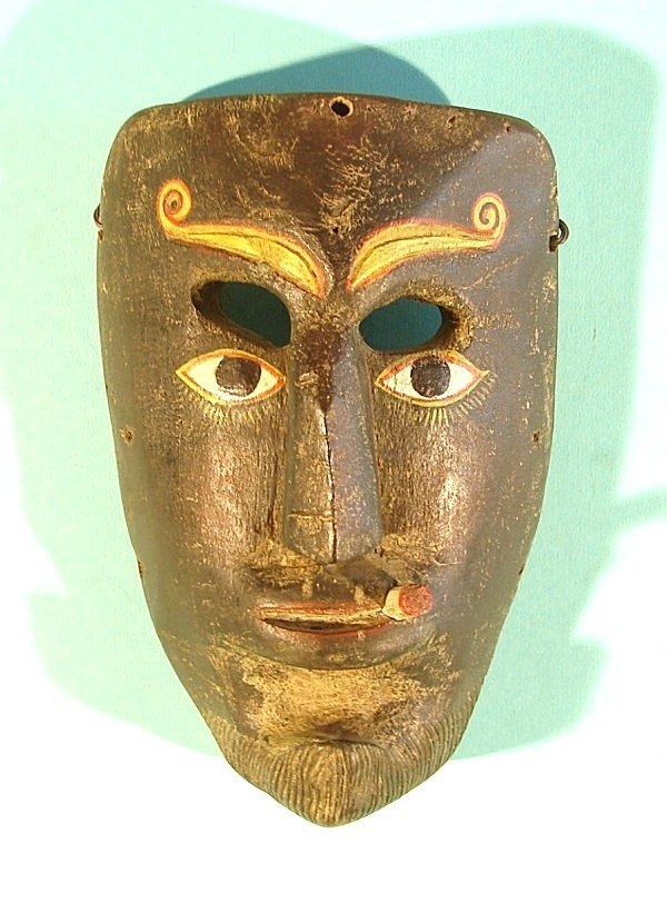 455: SMOKING MAN, a hand carved and painted wood mask,