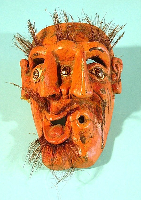 459: FACE OF SORROW AND JOY, a hand carved and painted