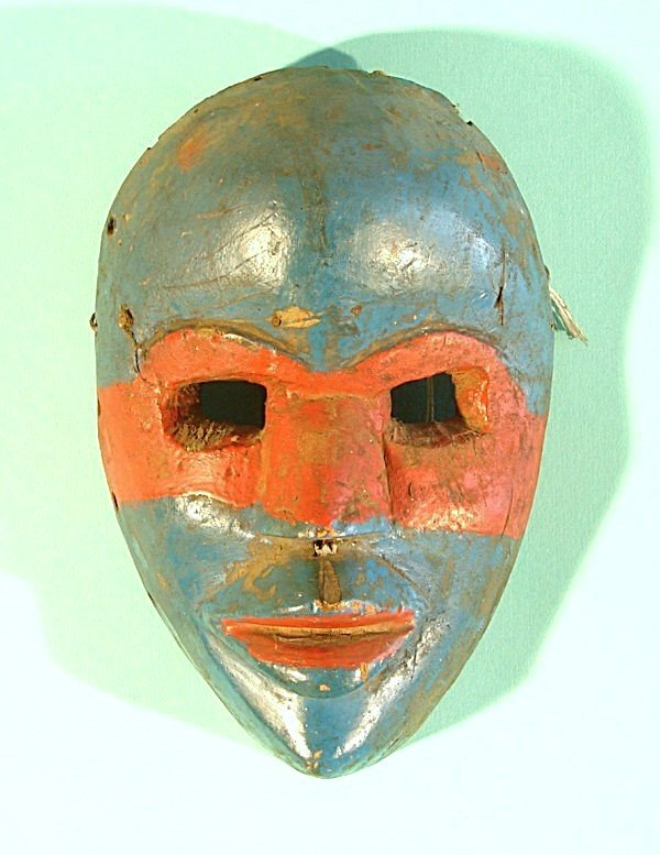 460: Hand carved and painted wood mask with nails along