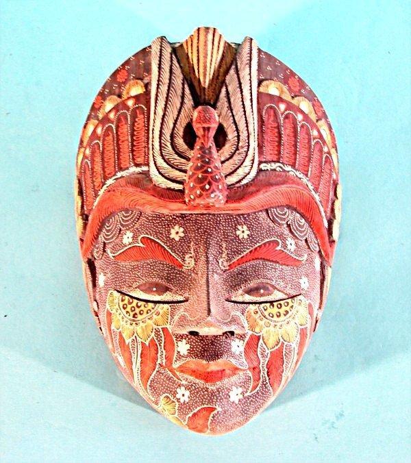 463: FACE WITH BIRD HEADDRESS, an Asian-style hand carv