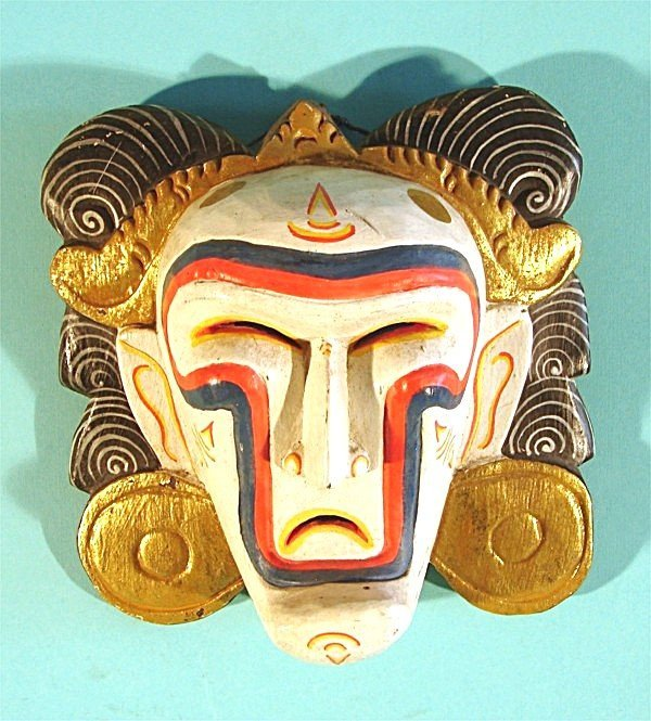 465: An Indonesian hand carved and painted wood mask, 8