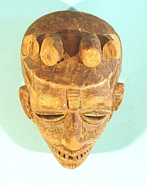 472: A hand carved and partially painted wood mask with