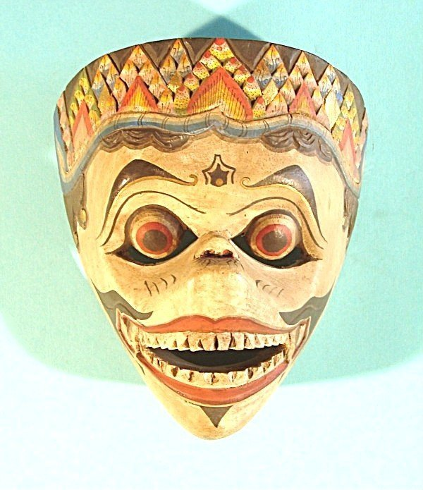 473: An Indonesian style hand carved and painted mask,