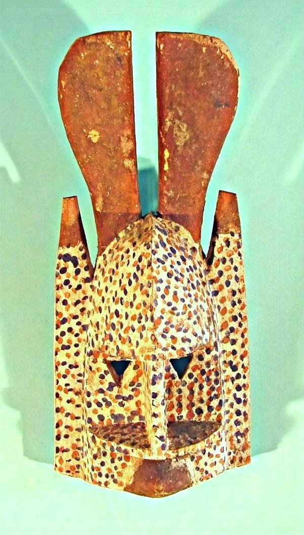 """474: A hand carved and painted wood mask, 15"""" tall, 7"""""""