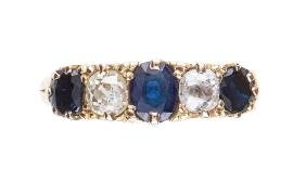 A five stone sapphire and diamond ring , the oval cut