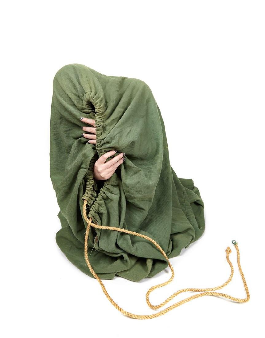 Houdini, Harry - A green, oversized, canvas sack used