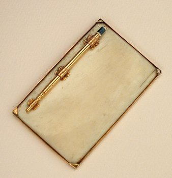 7E: GOLD AND ENAMEL PENCIL WITH IVORY NOTEPAD