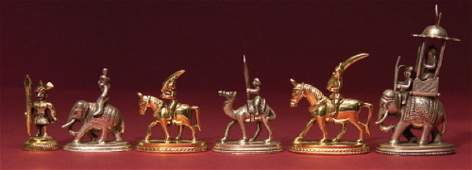 223: INDIAN `SILVER-COLOURED AND GILT METAL´ FIGURAL