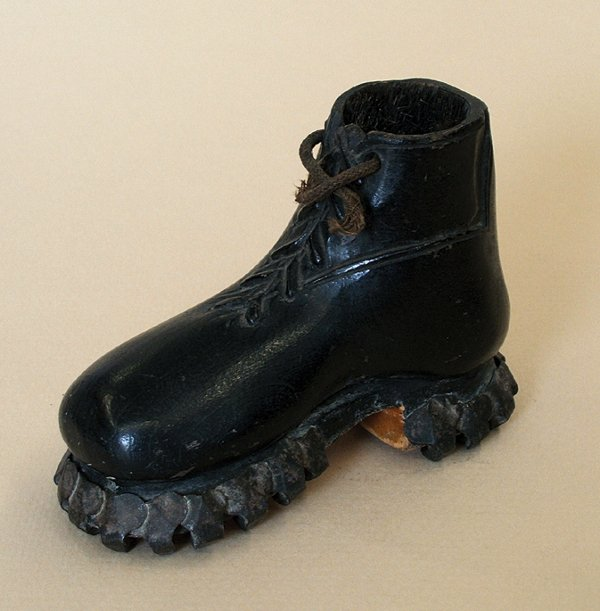 22A: A WOODEN 'BOOT' PENWIPE, late 19th century