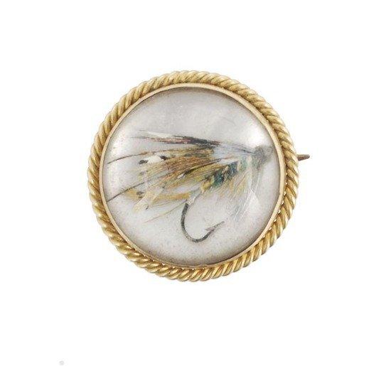 596: A Victorian reverse crystal intaglio brooch, the c