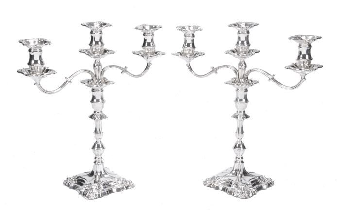 23: A pair of silver twin branch three light candelabr