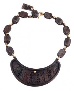 6: An Egyptian influenced part oxidised necklace by J
