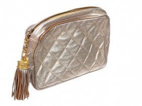 21: Chanel, a quilted gold metallic leather clutch han