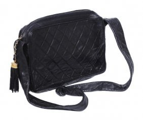 23: Chanel, a medium quilted black leather clutch styl