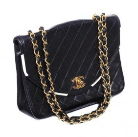 28: Chanel, a quilted black leather handbag, the D sha